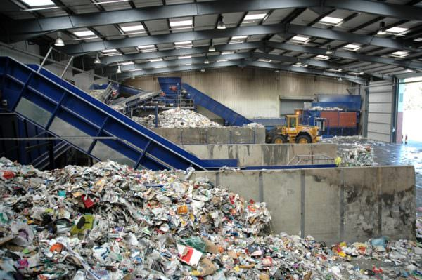 piles of solid waste at a recycling facility